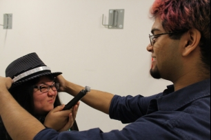 Integrating costumes and technology: Rhys Mendes (right) fits an infrared light strip to student Shianney Zaelani's fedora