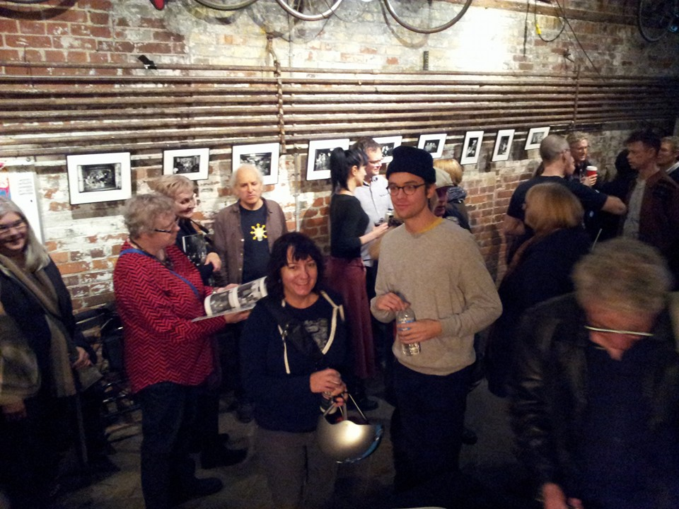 Exhibit of framed photos from the book with the8fest board members Tanya Read and Cameron Moneo. Photo by John Porter.