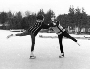 black and white image of two girls skating