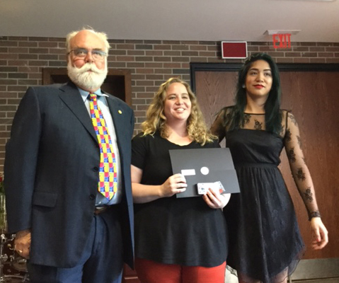 Danielle Taylor (centre) recieves the Winters fellows Scholarship from Peter McKinnon (left) and Angelica Grospe (right)