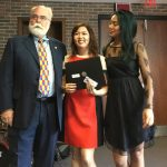 Queenie (Kwan Yee) Chu (centre) receives the Winters fellows Scholarship from Peter McKinnon (left) and Angelica Grospe (right)