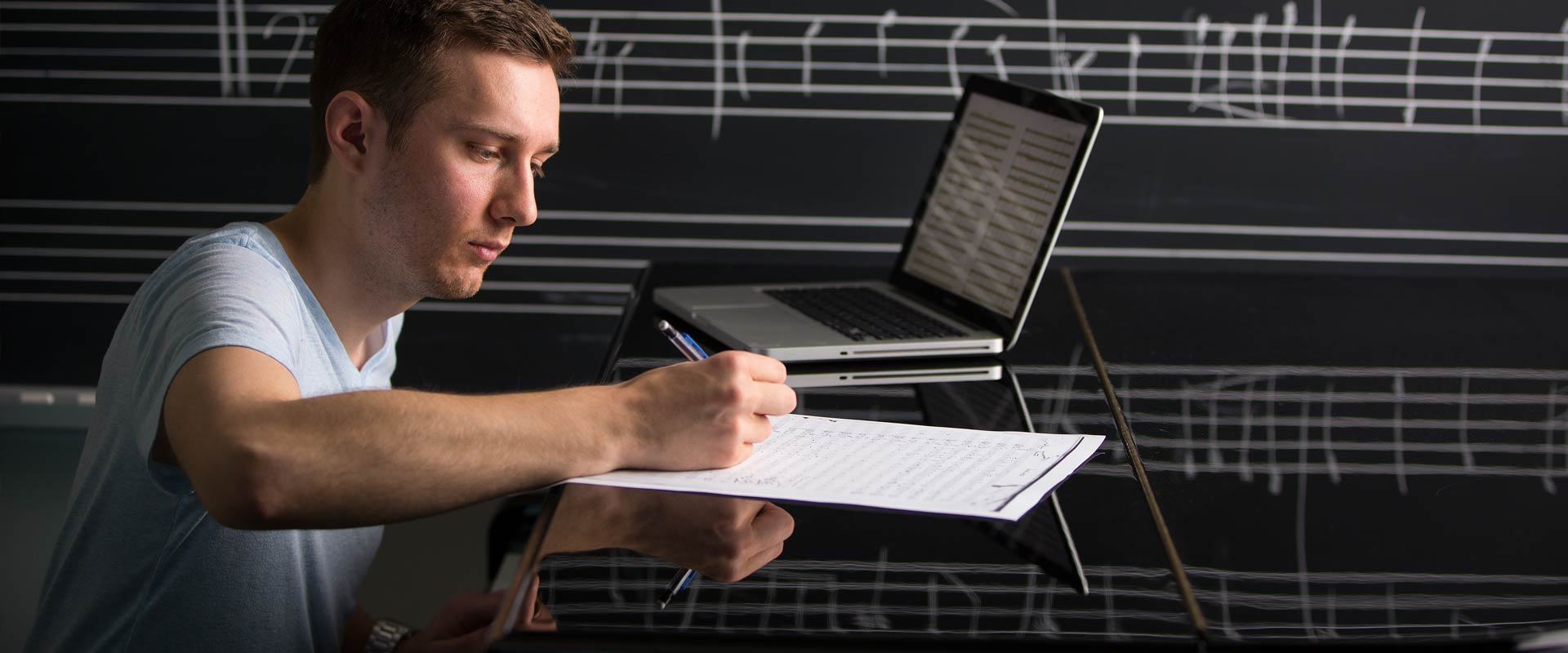 Male student composing music