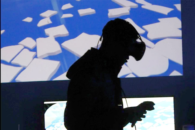 Man wearing virtual reality headset plays a game called North Bear
