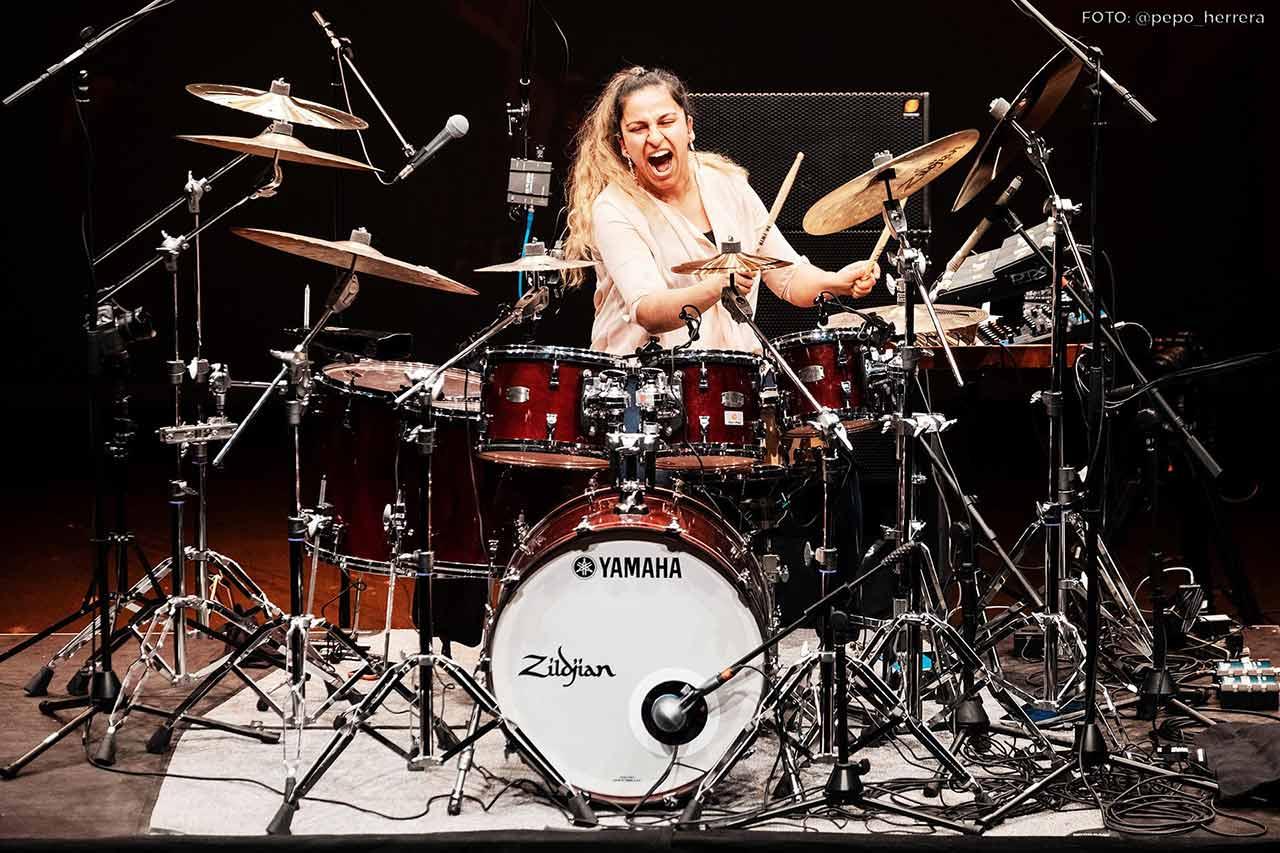 Sarah performing at the Tam Tam Drum Fest in Seville, Spain.