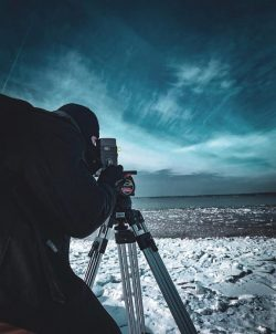 A man shoots a film in a cold landscape
