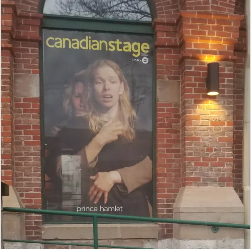 Canadian Stage poster in a window