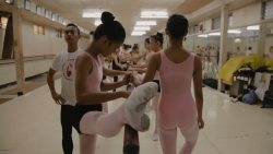 Ballet dancer stretches at barre