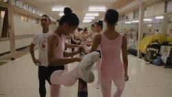 Ballet dancer stretches at barre