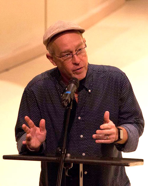Dave Douglas speaks on a stage