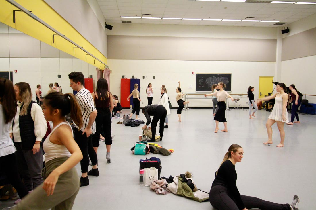 Dance students warming up in class