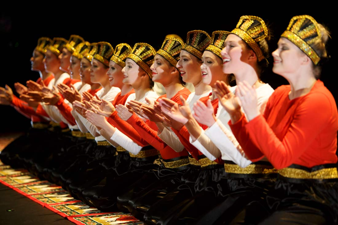 Row of dancers clapping