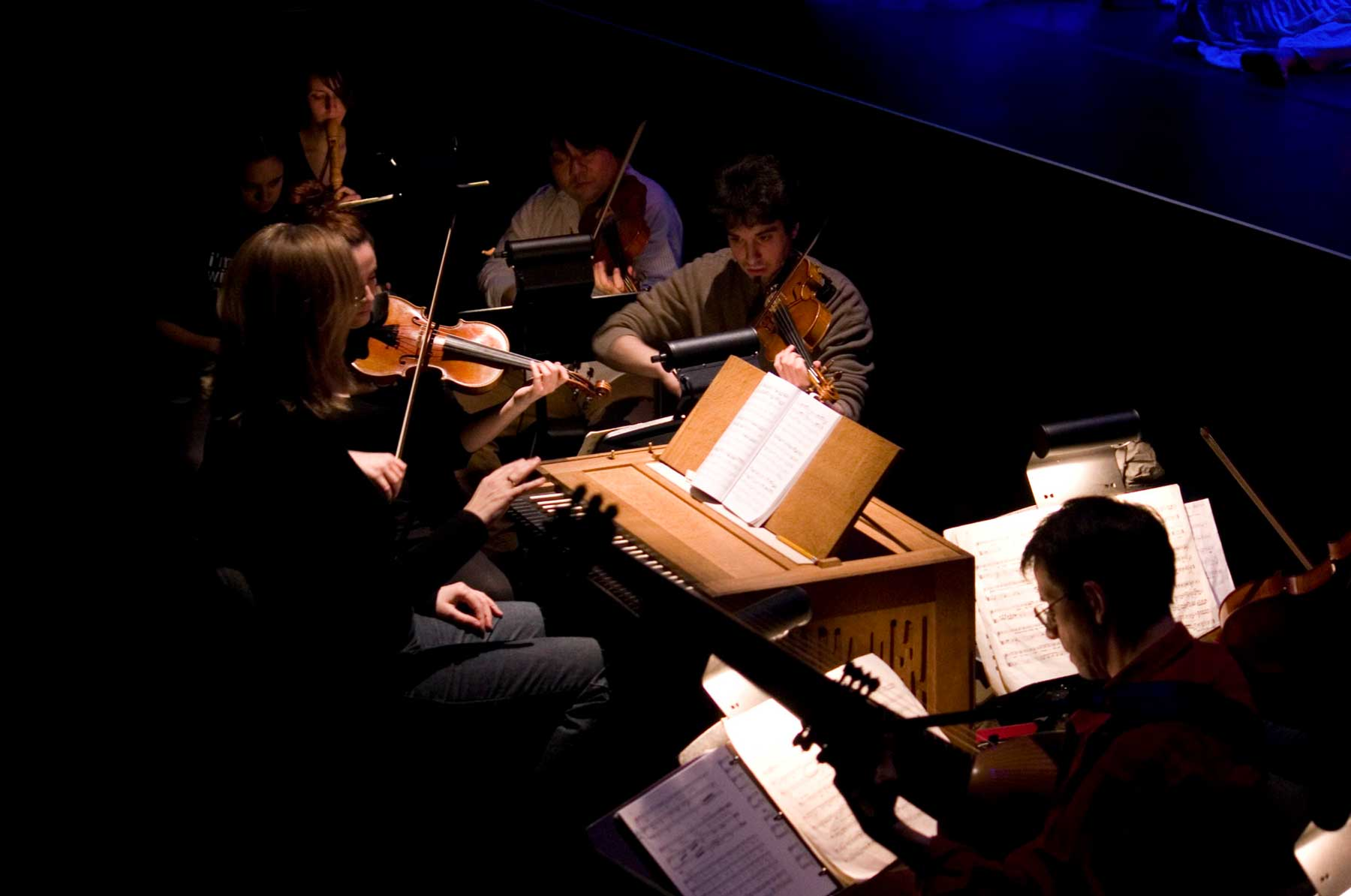 Students performing in orchestra pit