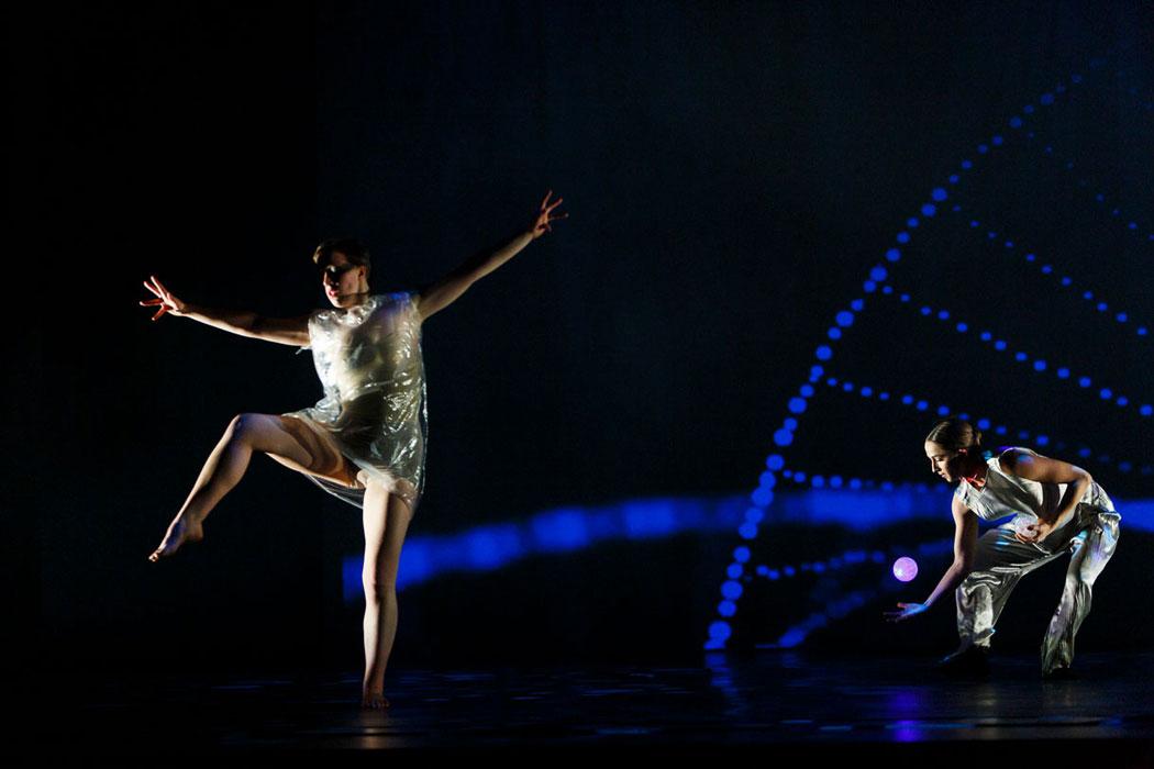 2 dancers in strange sci-fi costumes perform IM•MORTAL