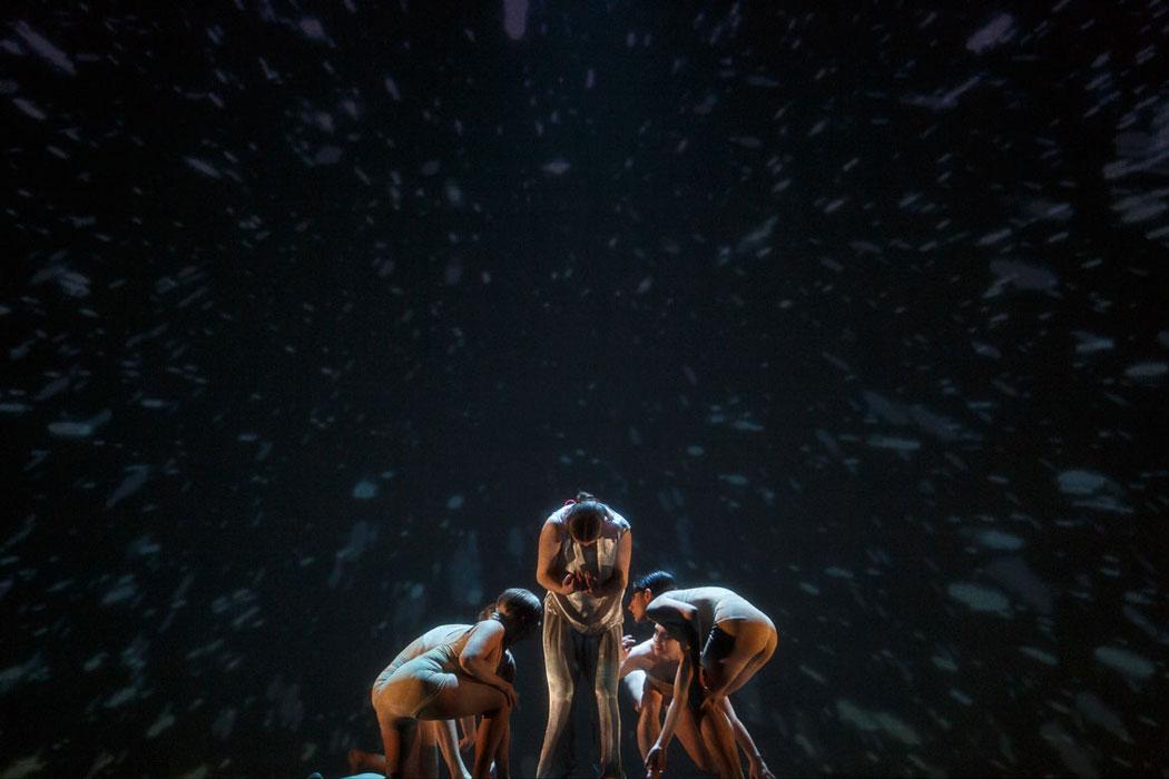 Dancers are huddled in IM•MORTAL