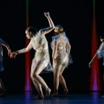 4 dancers wear clear plastic outfits as they dance in IM•MORTAL