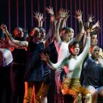 Dancers raise their hands in Language of Landscape