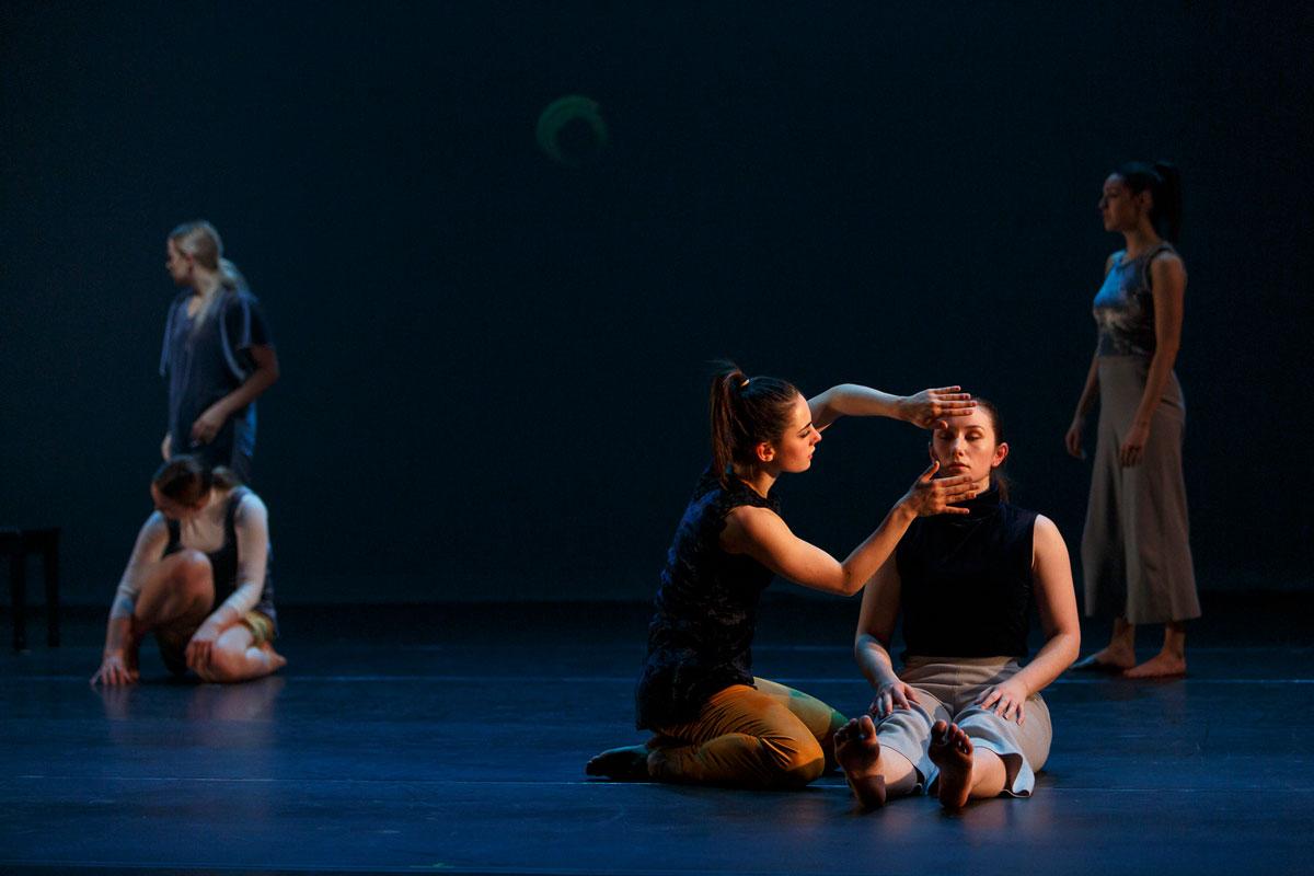Dancers explore faces on the floor in Language of Landscape