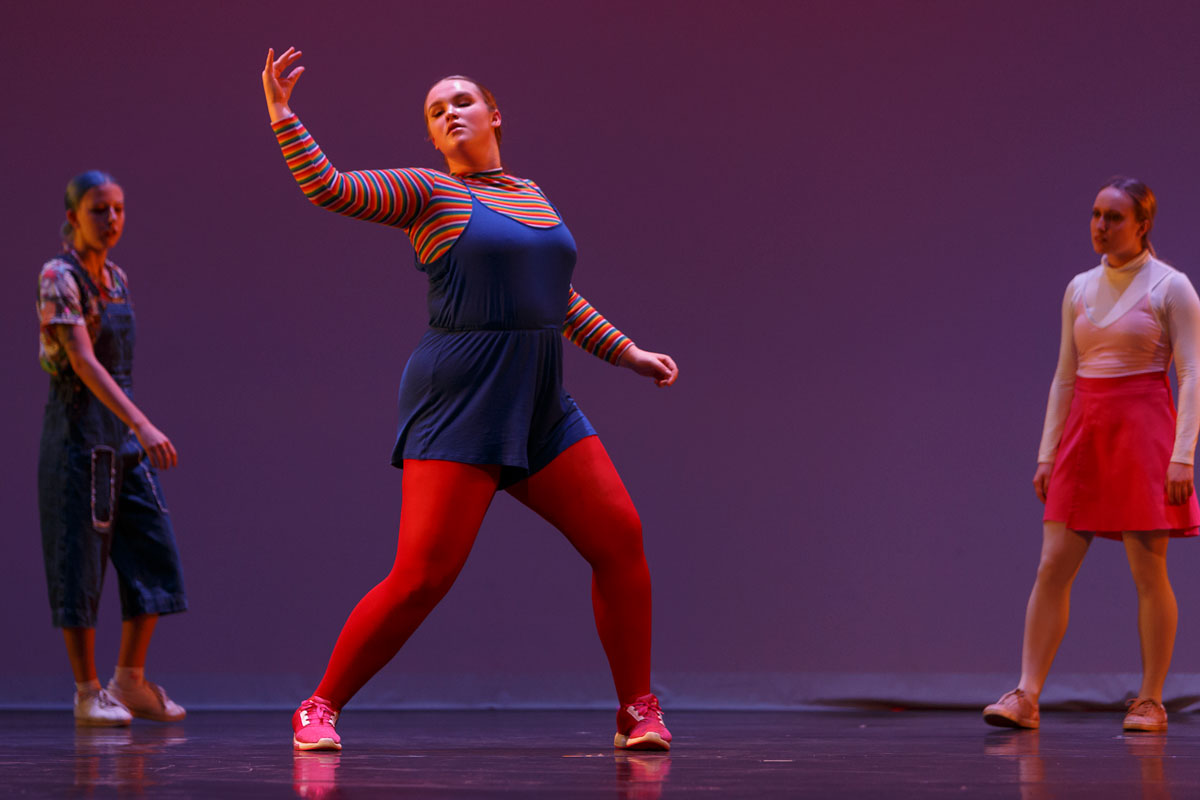 Three dancers appear on stage in Pina Pt. 2