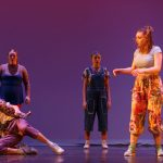 Five dancers appear on stage in Pina Pt. 2