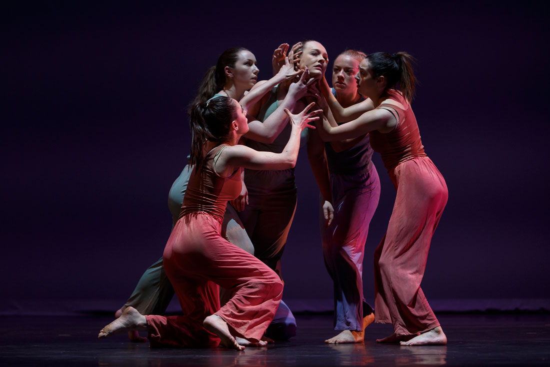 A group of dancers on stage in Theta Waves