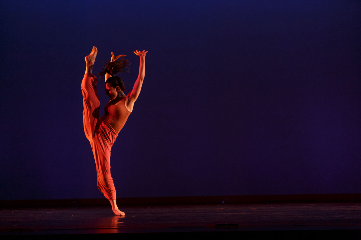 A dancer does a high kick in Theta Waves