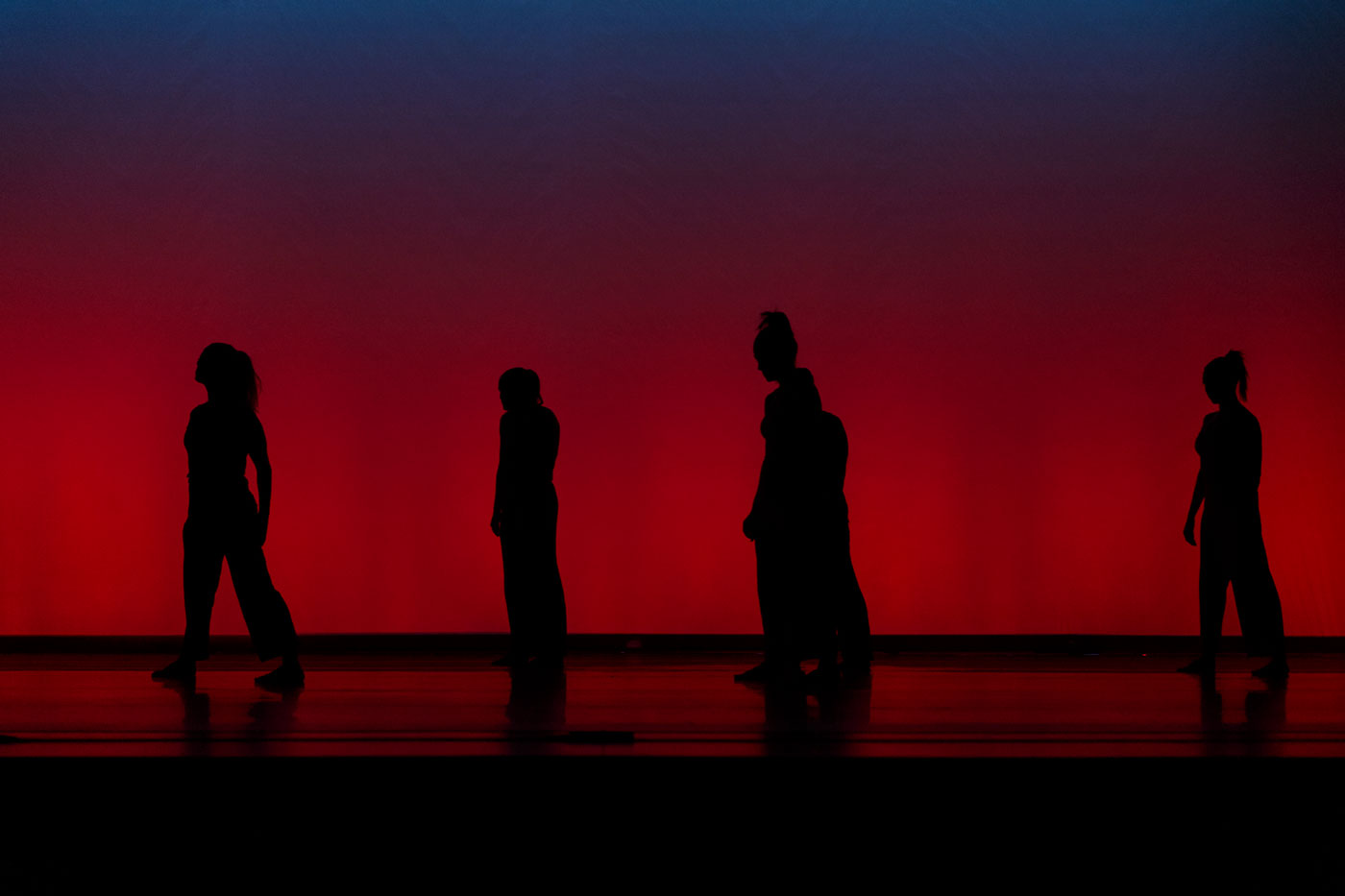 Silhouettes of dancers in Theta Waves