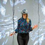 Woman wears a VR headset.