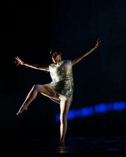 Dancer balances on one leg.