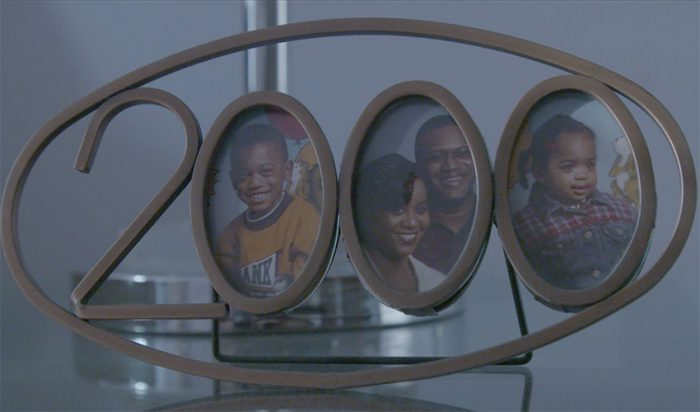 "A still from Samantha Bryan's ""Departed Bonds"" of a family photo frame"