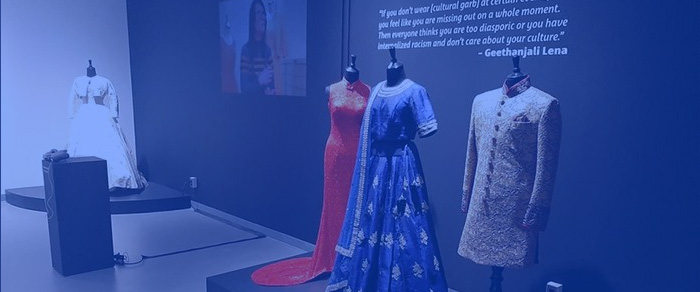 Fashion exhibition curated by Jason Cyrus with a blue overlay
