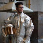 Moses Viveiros wears protective gear in the sculpture studio
