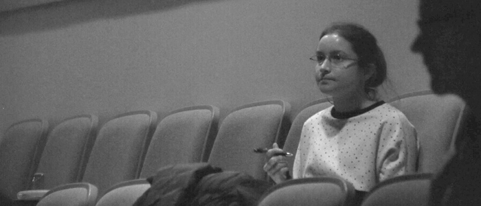 Amy Hull takes notes, seated at a rehearsal for Old Habits