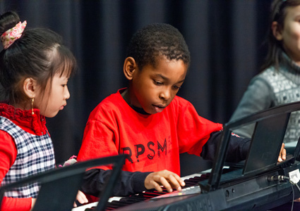 A child plays the keyboard