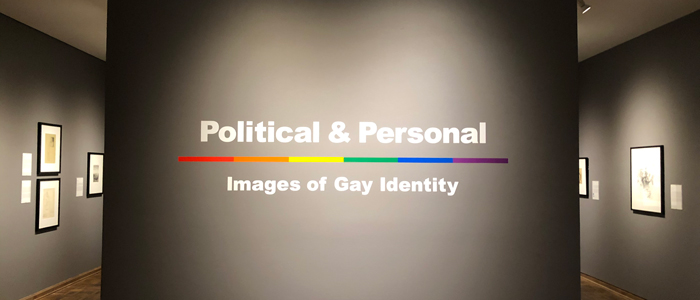 gallery space with title on wall that reads Politcal and Personal images of gay identity