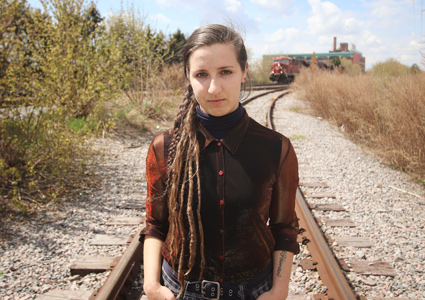 Sophie Dow stands on an abandoned railroad